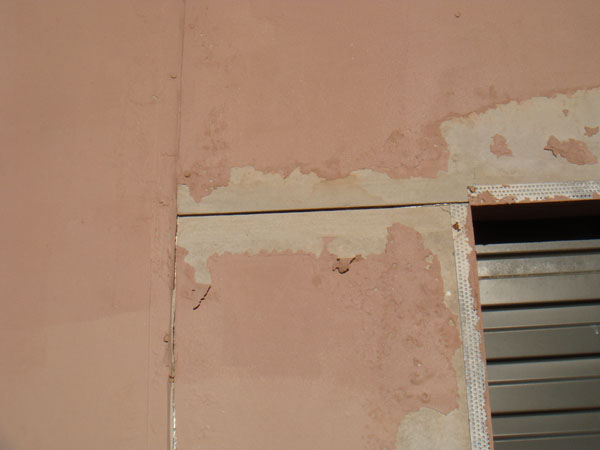 Peeling Render reported in Building Inspection